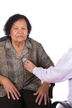doctor listening to elderly patient's heart