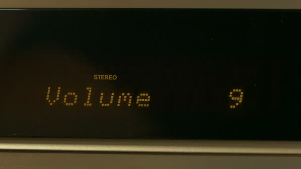 Turning up or down the volume on a av receiver , close up