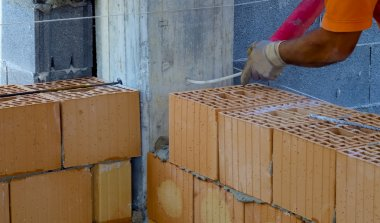 Reinforcement steel bars on pillars and layers of bricks