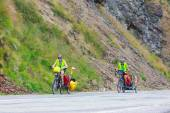 Fagaras Mountains, Romania - JULY 21, 2014: Unidentified cuple of cyclists going to road in Fagaras Mountain, Romania. Cycling is one of the most popular adventure sports in the world