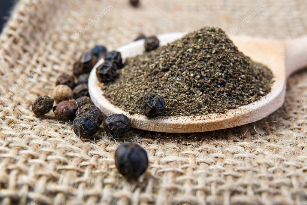 black pepper on the wooden spoon