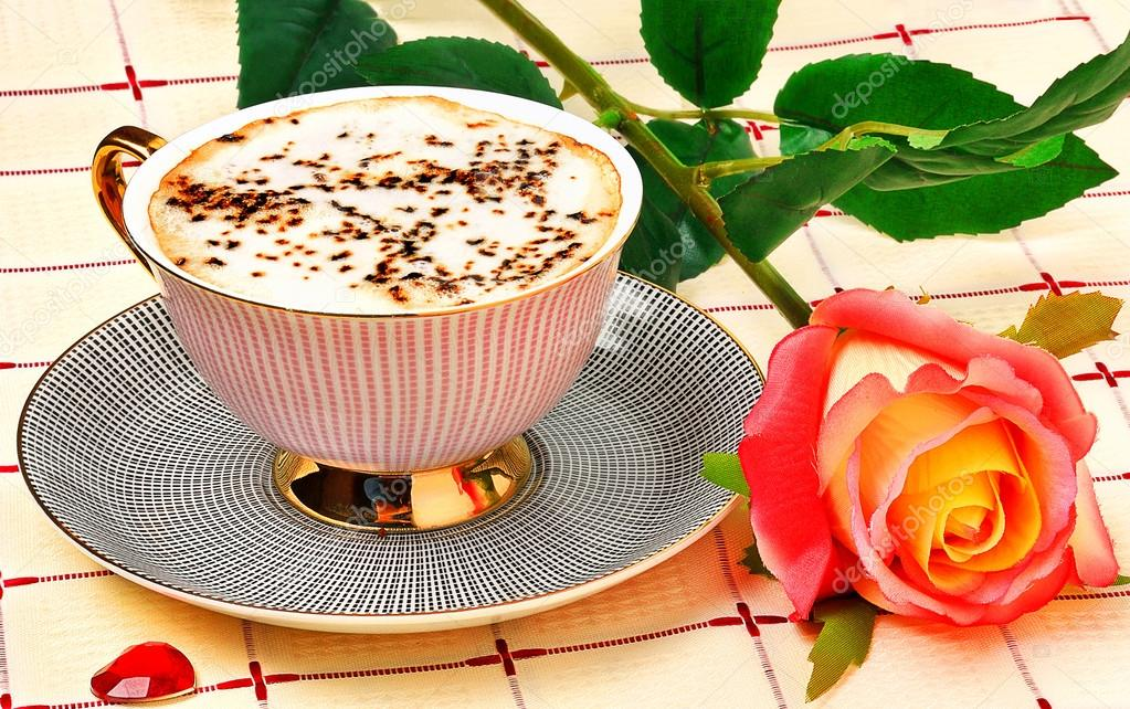 https://st2.depositphotos.com/1662158/8690/i/950/depositphotos_86909480-stock-photo-cappuccino-and-rose-on-tablecloth.jpg