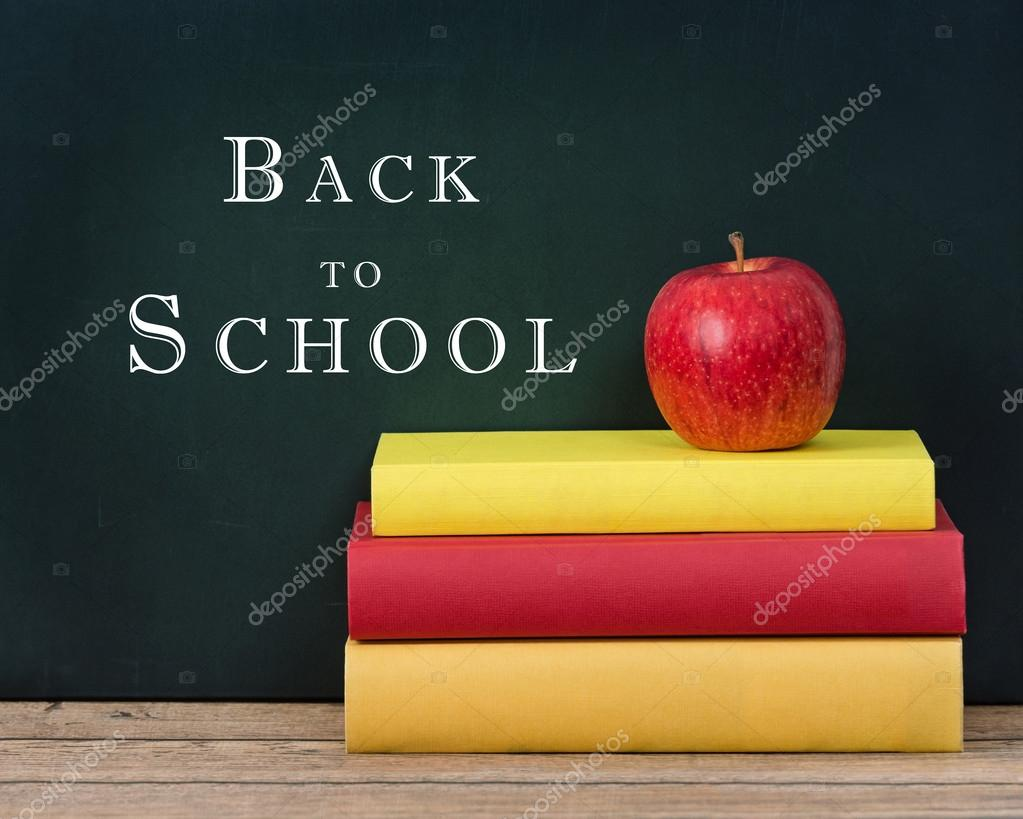 Apple On The Stack Of Books And Chalkboard Background Stock Photo
