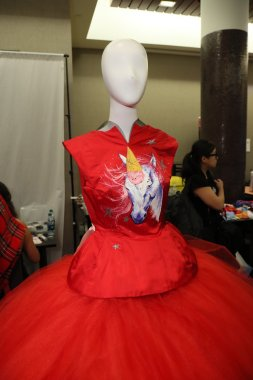 Red ball gown backstage