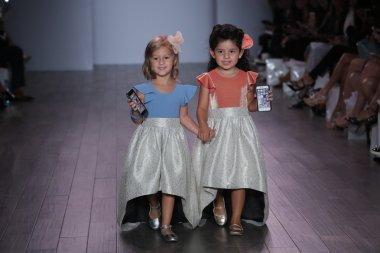 Kid models walk the runway during Raul Penaranda Runway show