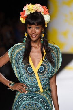Model walks the runway at Desigual during Mercedes-Benz Fashion Week Spring 2015
