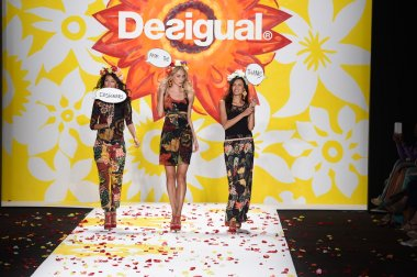 Models walk the runway finale at Desigual during Mercedes-Benz Fashion Week Spring 2015