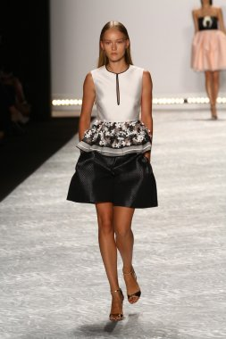 Model walks the runway at Monique Lhuillier during Mercedes-Benz Fashion Week Spring 2015