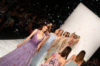Models walk the runway finale at Monique Lhuillier during Mercedes-Benz Fashion Week Spring 2015