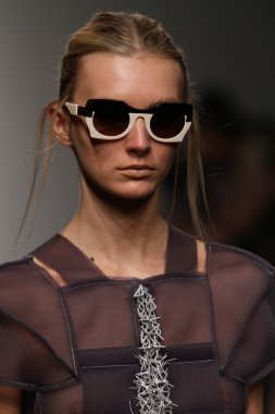 Model walks runway for Katya Leonovich Spring Summer 2015 fashion show