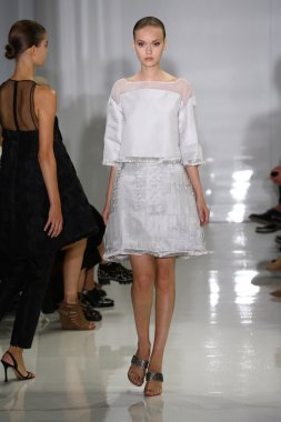 Model walks the runway at Ralph Rucci during Mercedes-Benz Fashion Week