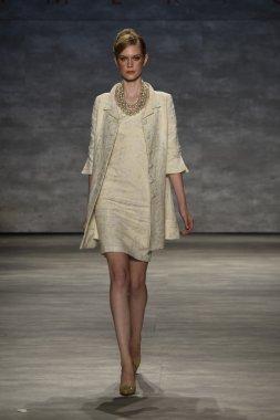 Model walks the runway at the B. Michael America fashion show