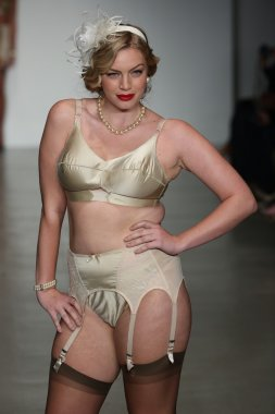 Model walks runway wearing Secrets in Lace lingerie Spring 2015 collection