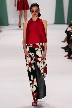 Model Ming Xi walk the runway at the Carolina Herrera fashion show