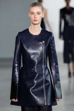 Model Sina walk the runway at the Calvin Klein Collection fashion show