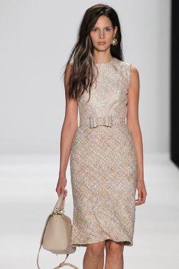 Model walks the runway at the Badgley Mischka fashion show