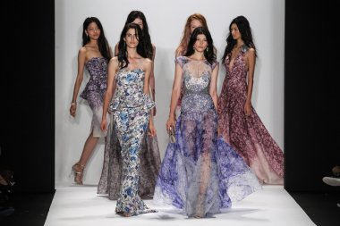 Models walk the runway at the Badgley Mischka fashion show