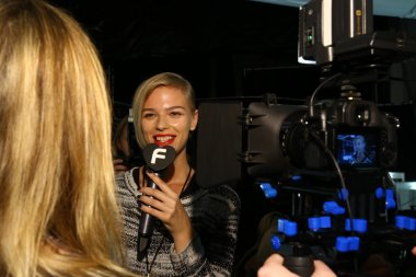 Model giving interview backstage at the Carmen Marc Valvo 25th show during MBFW
