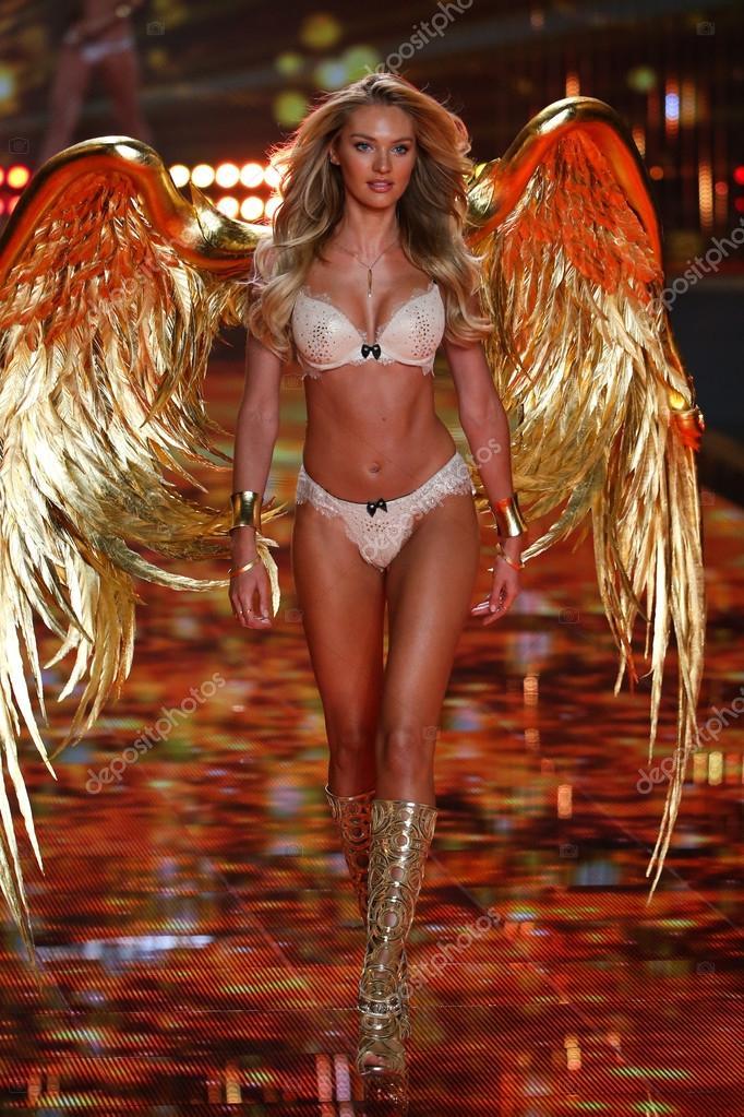 5b6ec63c09492 LONDON, ENGLAND - DECEMBER 02: Victoria's Secret model Candice Swanepoel  walks the runway during the 2014 Victoria's Secret Fashion Show on December  2, 2014 ...