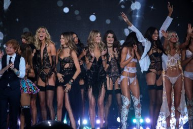 Victoria's Secret models with performers Hozier, Taylor Swift, Ed Sheeran and Ariana Grande