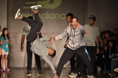 Dancers perform on runway at New Balance