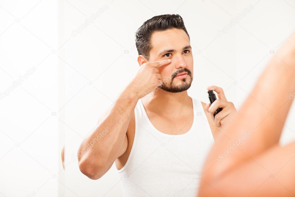 Man using some anti-aging cream — Stock Photo © tonodiaz #106980082