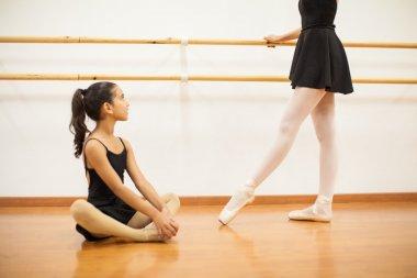 girl looking up to her dance teacher