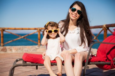 Mom and girl wearing sunglasses