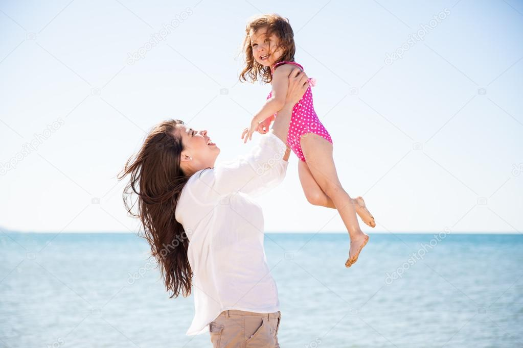 mother lifting her daughter up