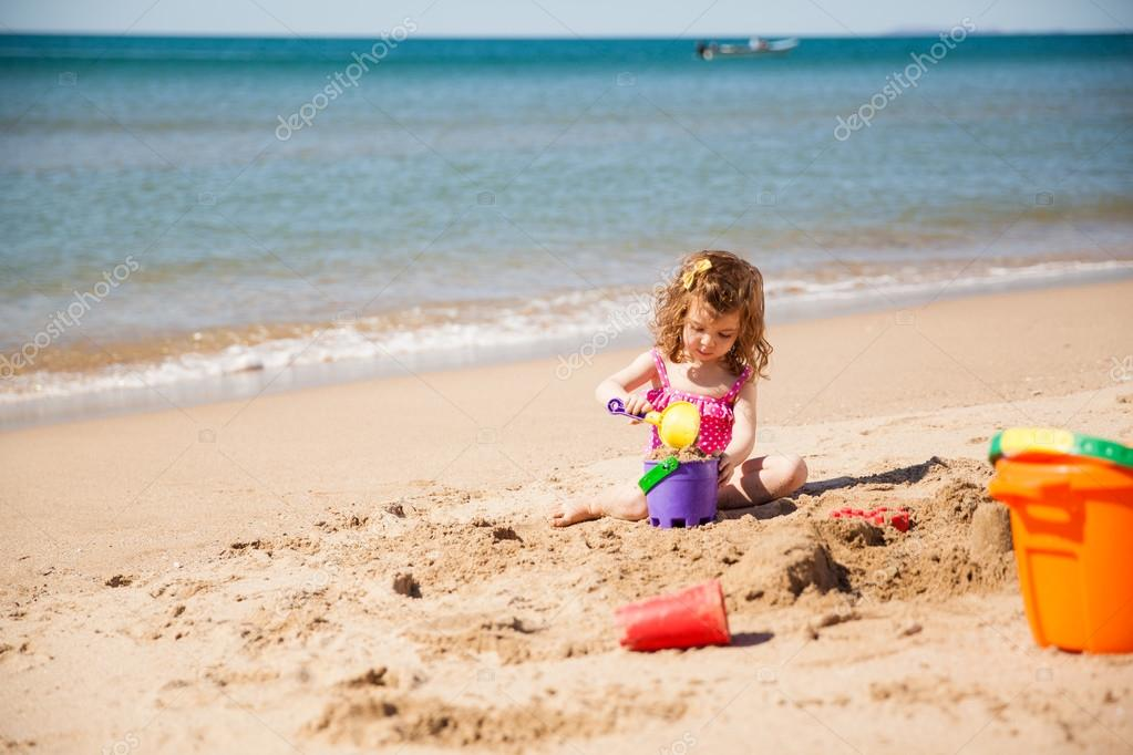 Girl in a bathing suit playing