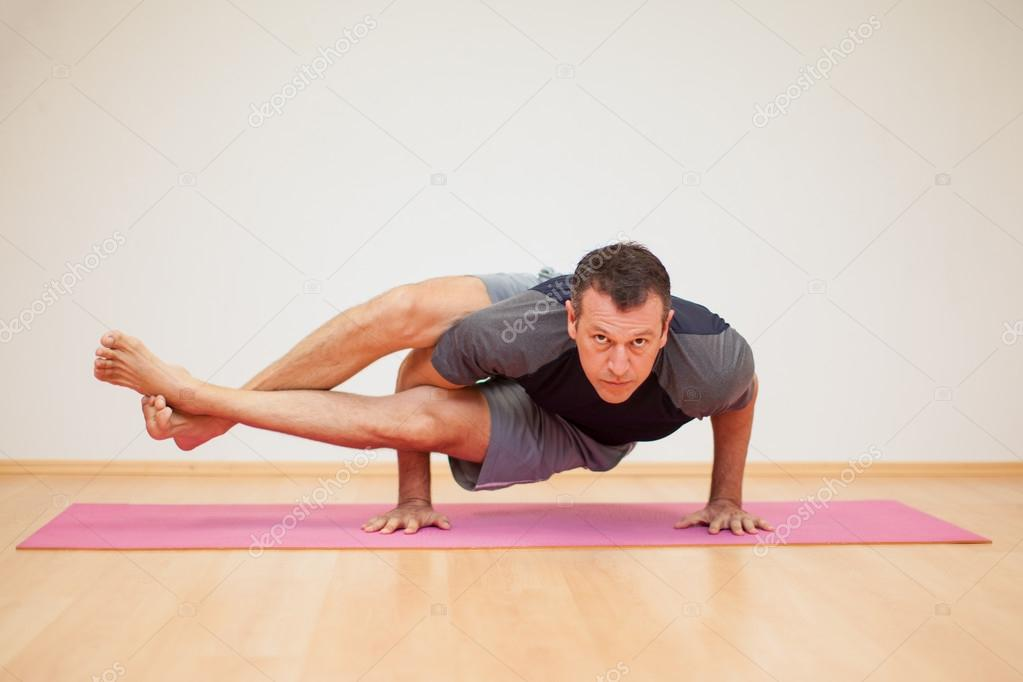 Man Practicing A Few Yoga Poses Stock Photo