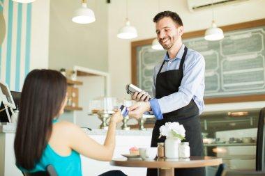 waiter taking a credit card