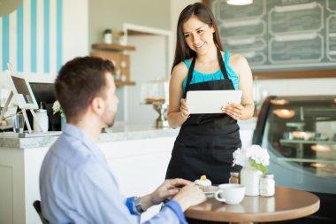 waitress using a tablet computer
