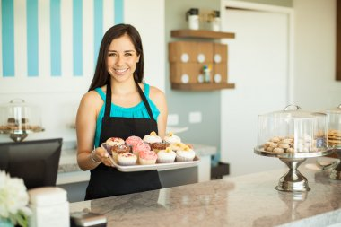 business owner showing cupcakes