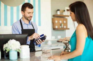 employee  swiping a credit card