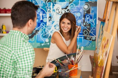 couple attending an art workshop