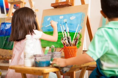 kids working on a painting