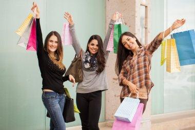 Women lifting a lot of shopping bags