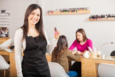 brunette holding a nail polish