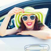 Photo happy woman  leaning out car window