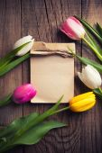 Colorful tulips with notepad