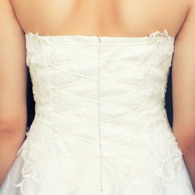 Brides back in white dress