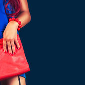 Photo Fashionable woman with a red bag