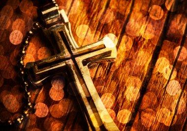Closeup of silver Christian cross on bokeh background stock vector