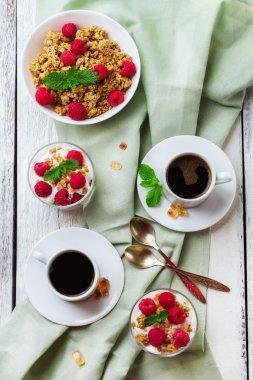 Breakfast concept. Coffee muesli granola berries homemade yogurt