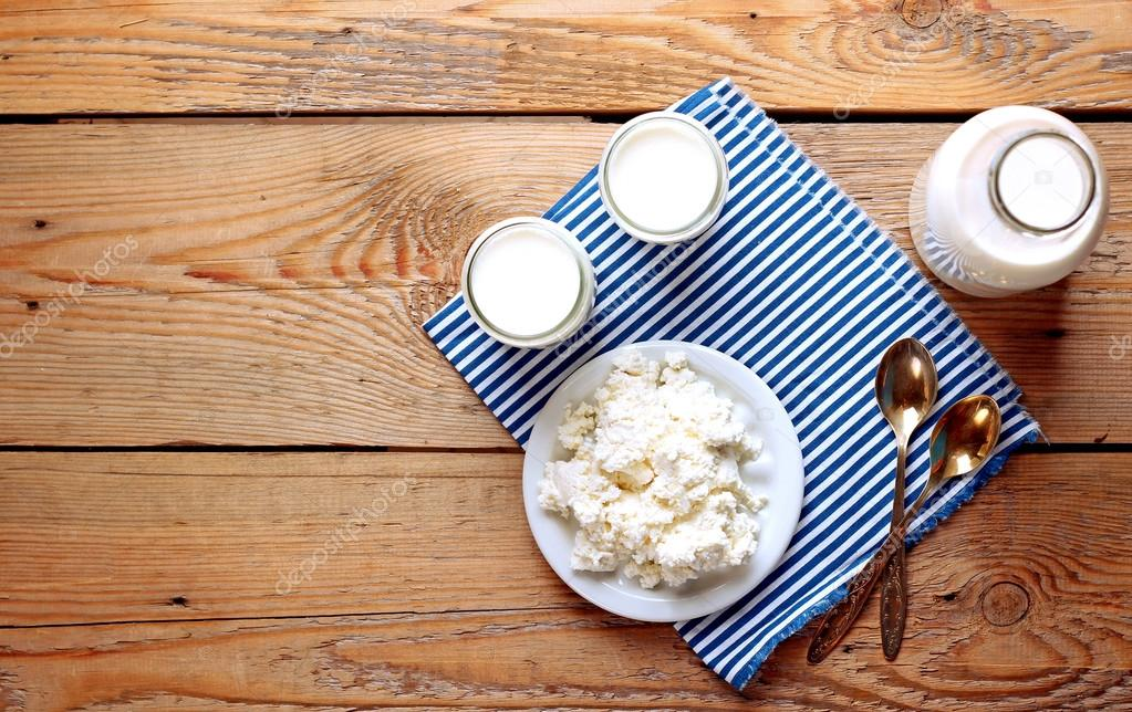 Assortment of diary products for breakfast (homemade yogurt, cottage cheese, milk)