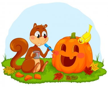 squirrel decorating pumpkin