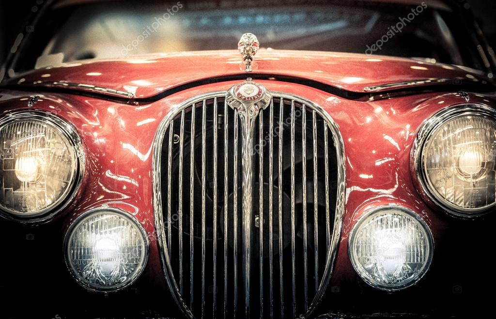 Front headlights and grille of vintage Jaguar.