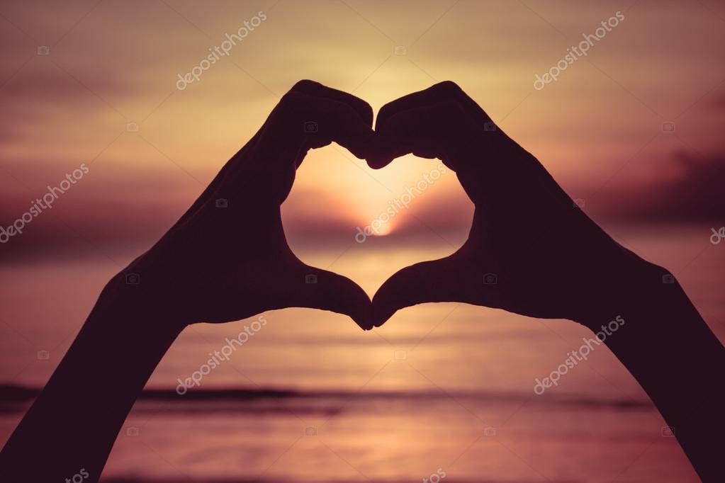 Hand Symbol Meaning Love At Sunset On The Beach Stock Photo