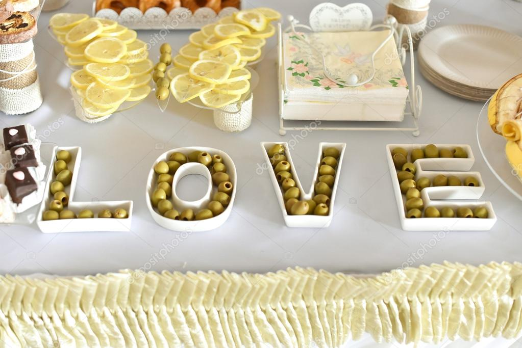 Love letters with olives on buffet table, catering